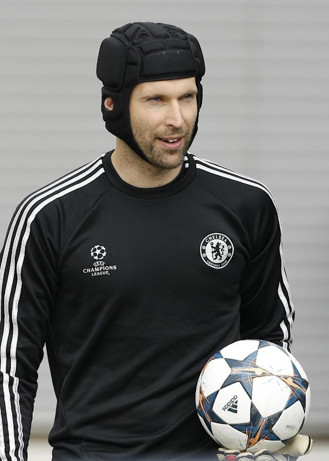 Chelsea's Petr Cech arrives for a training session at Cobham in England Tuesday, April 29, 2014. Chelsea will play a Champions League semifinal second leg soccer match against Atletico Madrid on Wednesday. (AP Photo/Kirsty Wigglesworth)