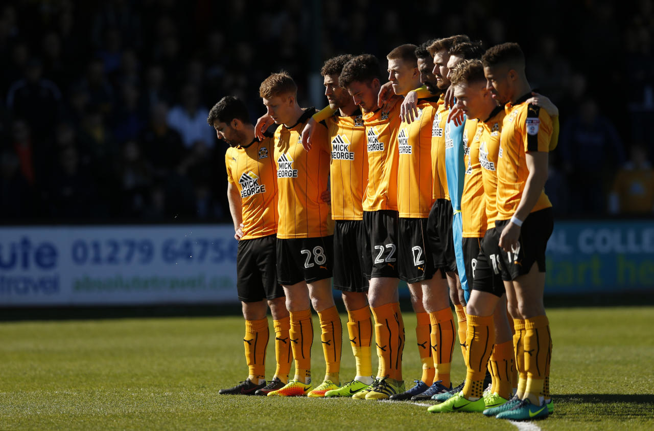 "Britain Football Soccer - Cambridge United v Stevenage - Sky Bet League Two - Cambs Glass Stadium - 25/3/17 Cambridge players observe a minutes silence in respect for the victims of the London attack before the game  Action Images via Reuters / Andrew Boyers Livepic EDITORIAL USE ONLY. No use with unauthorized audio, video, data, fixture lists, club/league logos or ""live"" services. Online in-match use limited to 45 images, no video emulation. No use in betting, games or single club/league/player publications.  Please contact your account representative for further details."