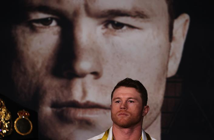 ARLINGTON, TEXAS - MAY 06:  Canelo Alvarez looks on against Billy Joe Saunders during the press conference for Alvarez's WBC and WBA super middleweight titles and Saunders' WBO super middleweight title at Live! by Loews hotel on May 06, 2021 in Arlington, Texas. (Photo by Al Bello/Getty Images)