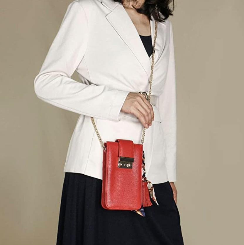 <p>The gold hardware on this <span>Travel Inspira Crossbody Phone Bag</span> ($20) is an irresistibly glam touch.</p>