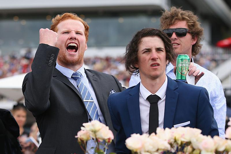 A punter celebrates a win while his mate seems less pleased on Melbourne Cup Day at Flemington in 2016. Source: Getty Images.