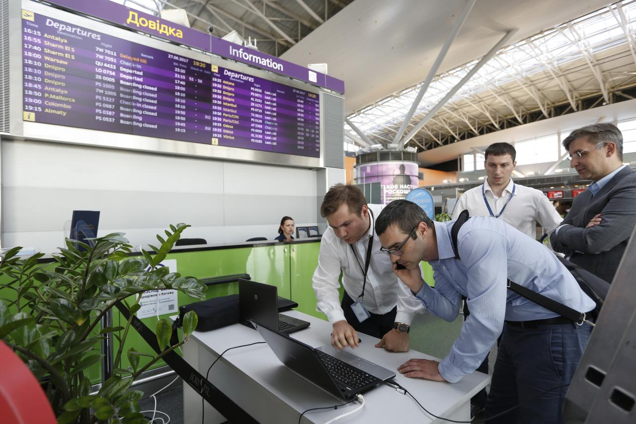 Airport employees work use a laptop computer at Boryspil airport in Kiev, Ukraine, Tuesday, June 27, 2017. A new and highly virulent outbreak of malicious data-scrambling software appears to be causing mass disruption across Europe, hitting Ukraine especially hard, with company and government officials reporting serious intrusions at the Ukrainian power grid, banks and government offices. (AP Photo/Sergei Chuzavkov)