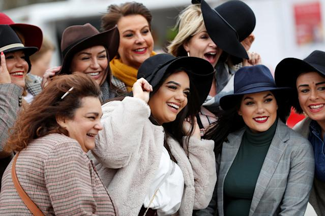 Horse Racing - Cheltenham Festival - Cheltenham Racecourse, Cheltenham, Britain - March 14, 2018 Racegoers pose for a photograph before racing REUTERS/Darren Staples