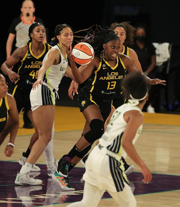 The Sparks' Chiney Ogwumike starts a fast break after grabbing a rebound May 14, 2021.