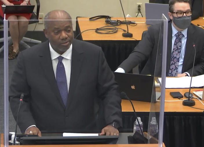 In this image from video, prosecutor Jerry Blackwell, left, speaks while defense attorney Eric Nelson, right, listens, as Hennepin County Judge Peter Cahill presides during opening statements, Monday, March 29, 2021, in the trial of former Minneapolis police officer Derek Chauvin, in the May 25, 2020, death of George Floyd at the Hennepin County Courthouse in Minneapolis, Minn. (Court TV via AP, Pool)