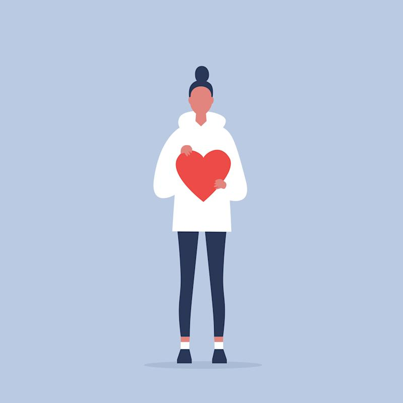 Saint Valentines Day. Young female character holding a red heart. Relationships. Love. Romance. Emotions. Flat editable vector illustration, clip art (Photo: nadia_bormotova via Getty Images)
