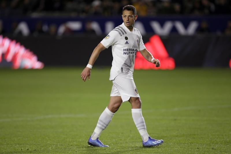 LA Galaxy forward Javier Hernandez walks on the pitch against the Vancouver Whitecaps during the second half of an MLS soccer match in Carson, Calif., Saturday, March 7, 2020. (AP Photo/Alex Gallardo)