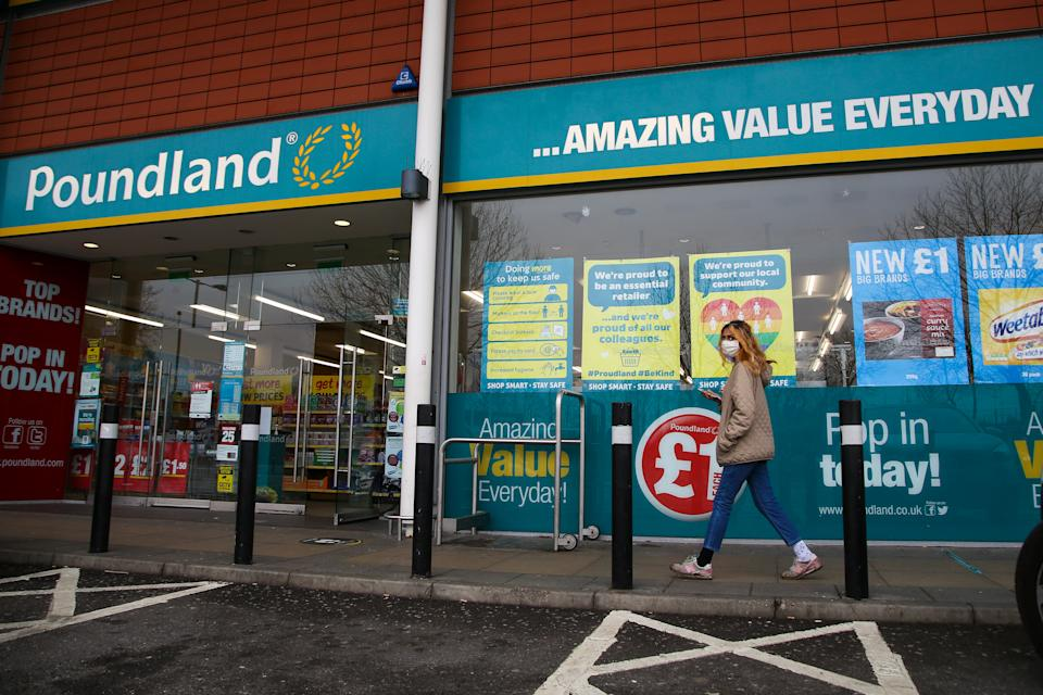LONDON, UNITED KINGDOM - 2021/03/18: A woman wearing a face mask walks past a branch of Poundland in London. (Photo by Dinendra Haria/SOPA Images/LightRocket via Getty Images)
