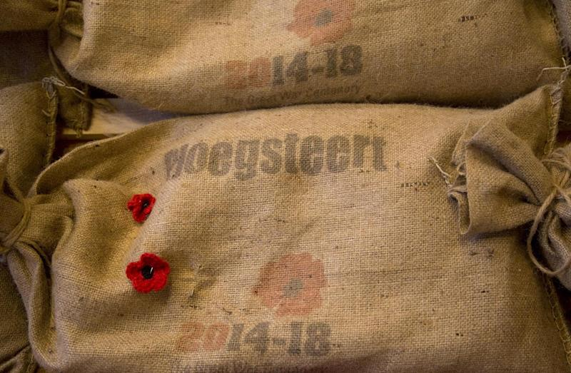 Sandbags, filled with soil from the World War I battlefields of Flanders, are piled at the In Flanders Fields Museum in Ypres, Belgium on Saturday, Nov. 9, 2013. The 70 sandbags, collected by Belgian schoolchildren from Commonwealth cemeteries in Belgium, will be handed over to the Duke of Edinburgh during an Armistice Day ceremony at the Menin Gate in Ypres on Monday, Nov. 11, 2013. The soil will then be placed in the Flanders Fields Memorial Garden at the Wellington Barracks in London. (AP Photo/Virginia Mayo)