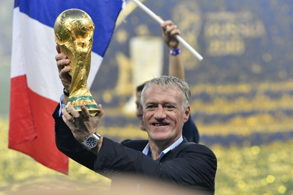 FILE - In this Sunday, July 15, 2018 filer, France head coach Didier Deschamps lifts the trophy after France beat Croatia by 4-2 during the final match between France and Croatia at the 2018 soccer World Cup in the Luzhniki Stadium in Moscow, Russia. France won the last major international soccer tournament — the World Cup in 2018 — by defending compactly, hitting teams on the break with clinical finishing, and being effective at set pieces. What will the winning approach be at the European Championship? (AP Photo/Martin Meissner, File)
