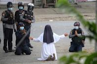 """The image of Sister Ann Rose Nu Tawng kneeling in the dust, arms spread, begging police not to shoot """"the children"""" went viral in March as an uprising swelled in Myanmar"""