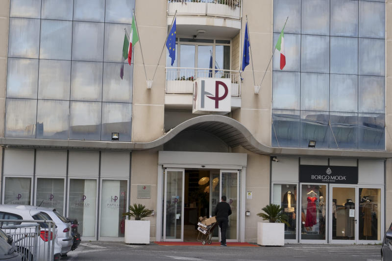 A view of the hotel where an American woman wanted in the 2002 death of her husband was arrested in Rome, Thursday, Feb. 13, 2020. An American woman wanted in the 2002 death of her husband, whose remains were so badly burned they weren't identified for more than a decade, was arrested in Rome after a multinational search, police said Thursday. Rome police arrested Beverly McCallum, 59, overnight after she and her teenage son checked into a Rome hotel on the northwest outskirts of the Italian capital. Italian hotels are required to register guests in an online system linked to a police database. (AP Photo/Paolo Santalucia)