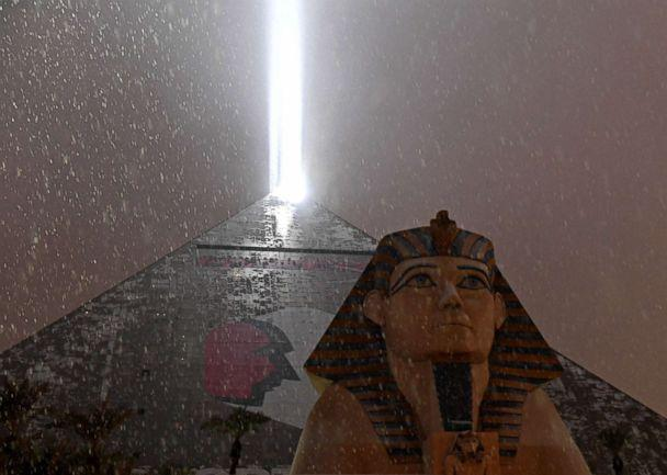 PHOTO: The light on top of Luxor Hotel and Casino illuminates snow falling during a winter storm, Feb. 20, 2019, in Las Vegas. (Ethan Miller/Getty Images)