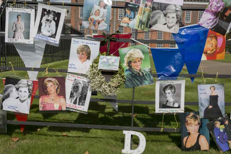 As crowds of royalist well-wishers gather, a spontaneous memorial of flowers, photos and memorabilia grows outside Kensington Palace, the royal residence of Princess Diana who died in a car crash in Paris exactly 20 years ago, on 31st August 2017 in London, United Kingdom. In 1997 a sea of floral tributes also filled this area of the royal park as well as in other relevant areas of London. Then, as now, royalists mourned the People's Princess. (Photo by Richard Baker / In Pictures via Getty Images Images)