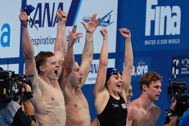 Team Great Britain celebrates winning the final of the mixed 4x100m medley relay swimming event at the 2015 FINA World Championships in Kazan on August 5, 2015 (AFP Photo/Alexander Nemenov)