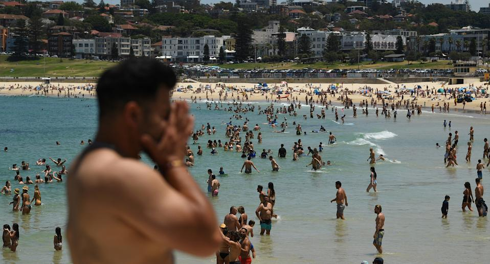 People seen on the sand during heatwave conditions at Bondi Beach in Sydney, November 28, 2020.
