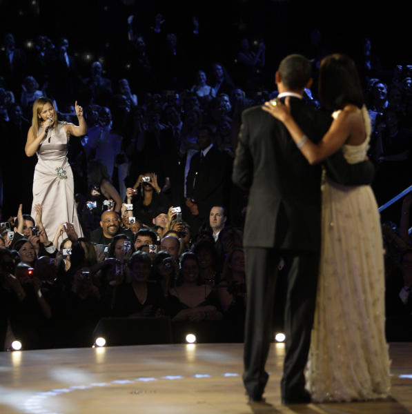 FILE -This Jan. 20, 2009 file photo shows Beyonce,left, singing as President Barack Obama and first lady Michelle Obama finish their dance at the Neighborhood Inaugural Ball in Washington. President Barack Obama's re-election campaign is getting a boost from pop stars Beyonce and Jay-Z. The superstar couple will hold a fundraiser with Obama on Tuesday at a swanky New York nightclub that Jay-Z owns. (AP Photo/Elise Amendola, File)