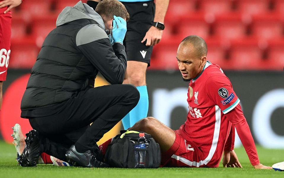 Liverpool's Fabinho picks up an injury during the UEFA Champions League Group D match at Anfield, Liverpool. - PA