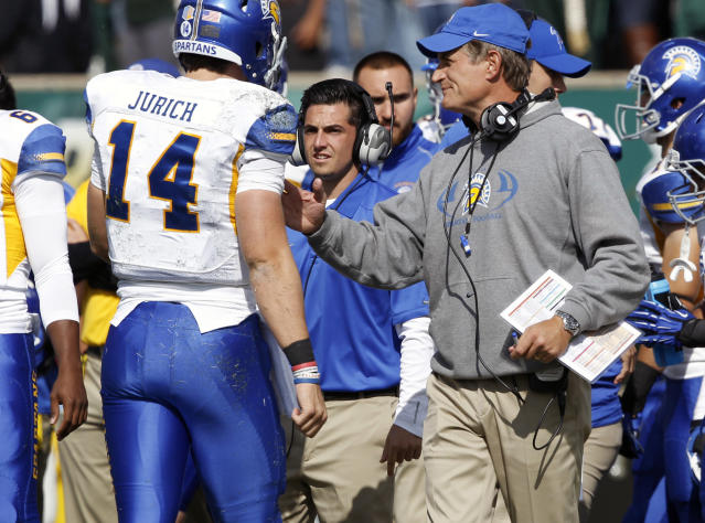 San Jose State head coach Ron Caragher, right, confers with quarterback Blake Jurich after he failed to get a first down on a run against Colorado State in the first quarter of an NCAA college football game in Fort Collins, Colo., on Saturday, Oct. 12, 2013. (AP Photo/David Zalubowski)