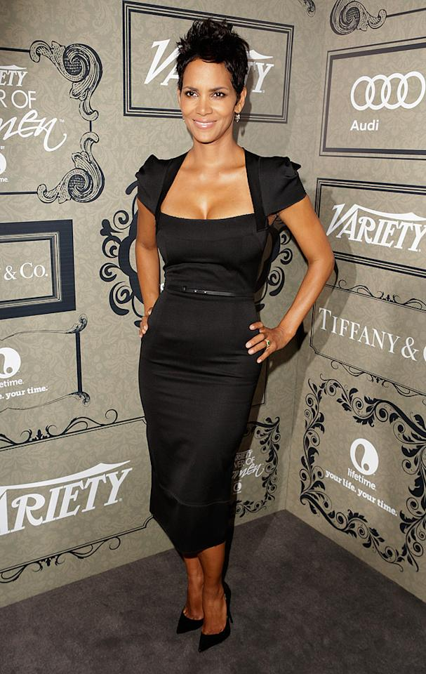 Truth be told, we kinda find Halle Berry's 'do a bit boring these days, but we'll never tire of seeing the gorgeous big screen star in designer duds. At this year's <i>Variety</i> Power of Women fete, the Oscar winner was poured into a Roland Mouret dress that successfully hugged her signature curves. Accessories included simple diamond earrings and pointy Jimmy Choo pumps. (10/5/2012)