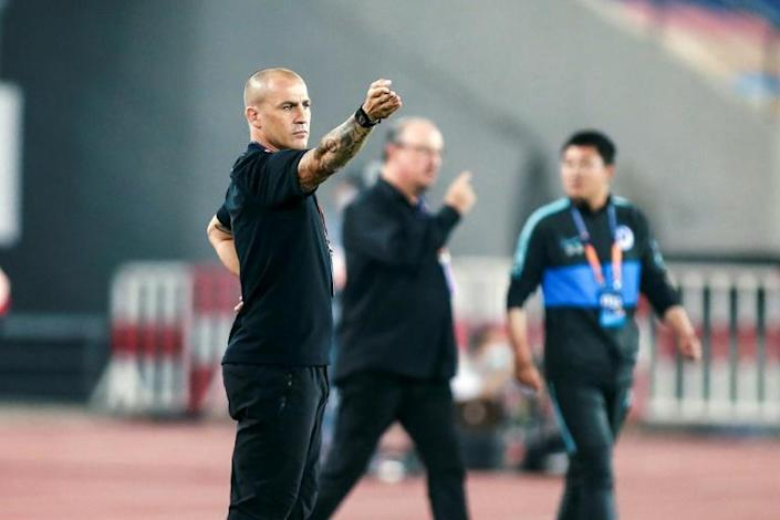 Former World Cup-winner Fabio Cannavaro (left) coaches at Guangzhou Evergrande and former Liverpool manager Rafael Benitez (centre) is in charge at Dalian Pro in the Chinese Super League