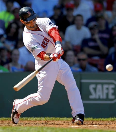 Boston Red Sox's Cody Ross hits a double RBI single off a pitch by Kansas City Royals' Luke Hochevar in the third inning of a baseball game at Fenway Park, Monday, Aug. 27, 2012, in Boston. (AP Photo/Steven Senne)