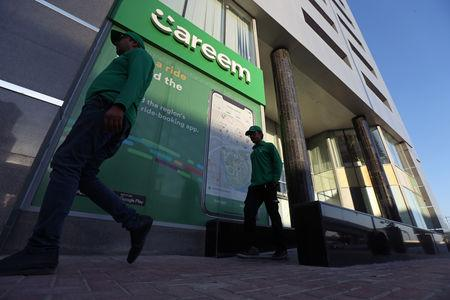 Careem employees walk past the company headquarters in Dubai, UAE December 13, 2018. Picture taken December 13, 2018. REUTERS/Satish Kumar
