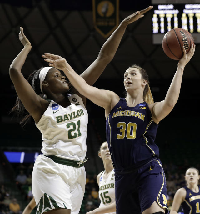 Baylor center Kalani Brown (21) defends against a shot by Michigan's Hallie Thome (30) in the first half of a second-round game at the NCAA women's college basketball tournament in Waco, Texas, Sunday, March 18, 2018. (AP Photo/Tony Gutierrez)