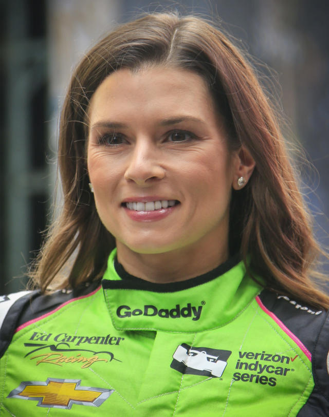 Danica Patrick poses after the unveiling of a life-size Lego statue creation of herself, Tuesday, May 22, 2018, in New York. (AP Photo/Bebeto Matthews)