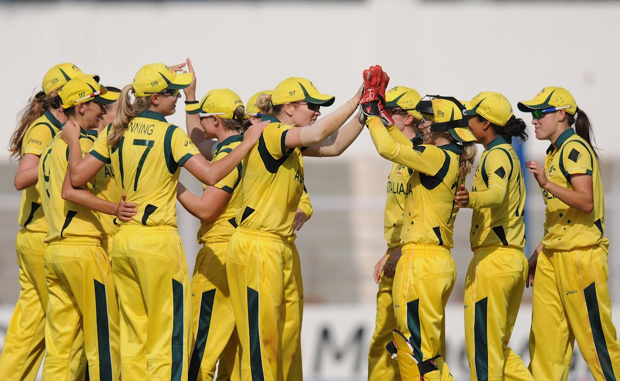 MUMBAI, INDIA - FEBRUARY 08:  Australia team celebrates  after winning the super six match  between England and Australia held at the CCI (Cricket Club of India)  on February 8, 2013 in Mumbai, India.  (Photo by Pal Pillai/Getty Images)