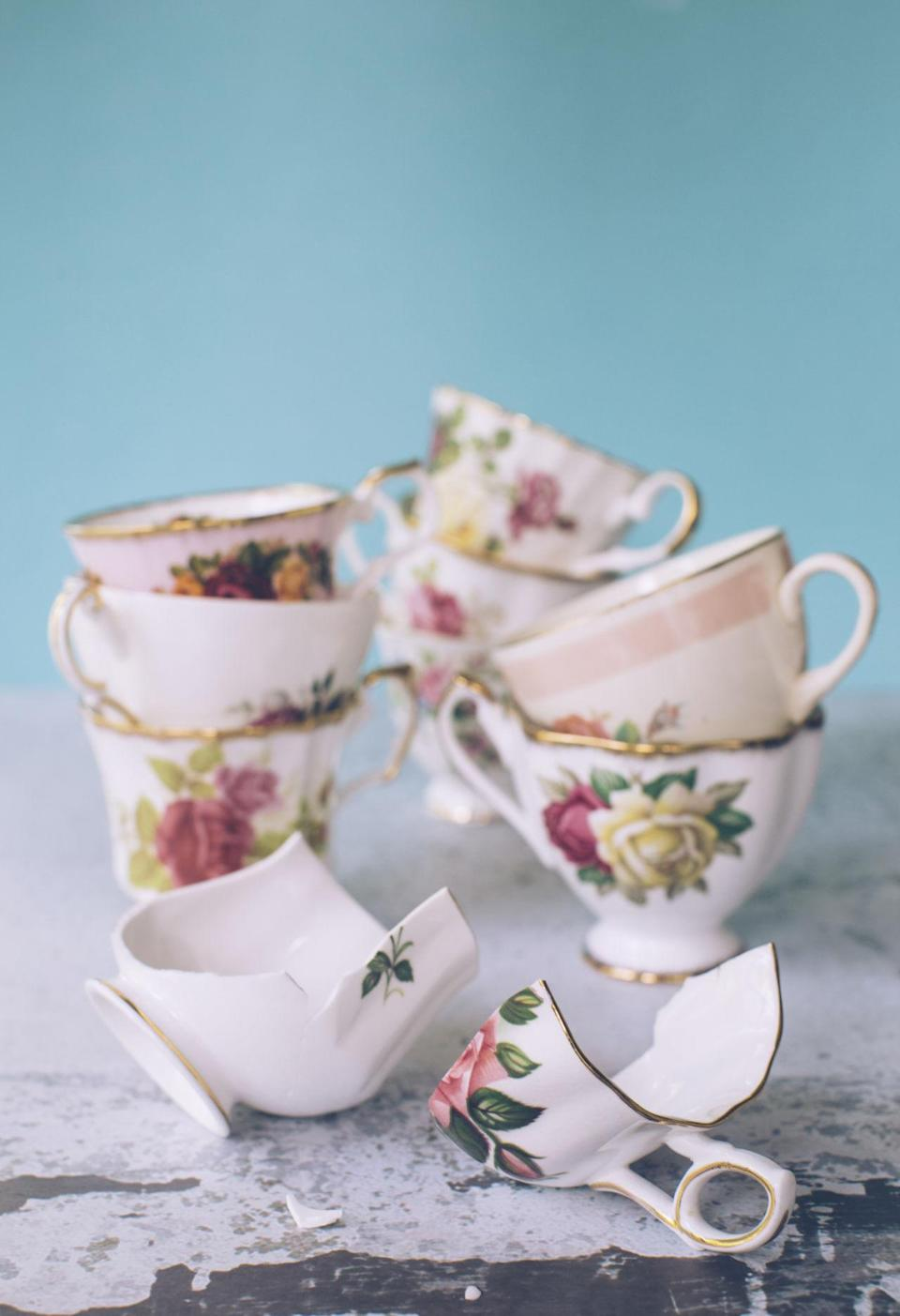 """<p>Every time you open the cabinet, there it is: The broken vintage teacup that you curse yourself for dropping, but still haven't gotten around to fixing. It might be past repair, but you still hesitate throwing it out. 'We're scared of not having enough, it's a poverty mentality,' says <a rel=""""nofollow noopener"""" href=""""http://www.anjiecho.com/"""" target=""""_blank"""" data-ylk=""""slk:Anjie Cho"""" class=""""link rapid-noclick-resp"""">Anjie Cho</a>, architect, certified feng shui consultant and founder of Holistic Spaces. 'Which really is about not feeling """"enough"""" or worthy in ourselves. The fear of letting go of things.'</p><p>Cho says that it's also about the fear of having to not just let go, but also having to buy something again if it turns out we needed it after all. It's an overall exhausting mental process to go through whenever you see the item in question. 'Cultivating the poverty mentality only perpetuates it, and surrounding yourself with broken items creates a similar broken energy in our inner and outer lives. It also creates a huge energy drain. Like every time you see that broken item that needs refinishing, you start to feel guilt,' she says. </p><p><strong>More: </strong><span><strong><em><a rel=""""nofollow noopener"""" href=""""http://www.housebeautiful.co.uk/lifestyle/storage/news/a154/kitchen-storage-solutions/"""" target=""""_blank"""" data-ylk=""""slk:Kitchen storage solutions: how to ditch the clutter"""" class=""""link rapid-noclick-resp"""">Kitchen storage solutions: how to ditch the clutter</a></em></strong></span></p>"""