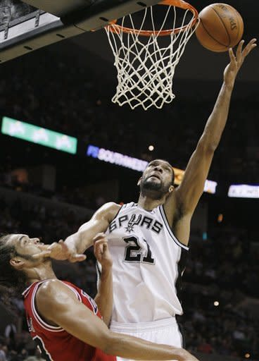 San Antonio Spurs' Tim Duncan, right, shoots over Chicago Bulls' Joakim Noah during the first half of an NBA basketball game on Wednesday, Feb. 29, 2012, in San Antonio. (AP Photo/Darren Abate)