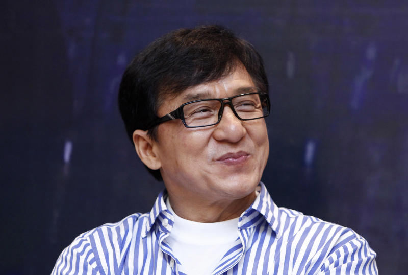 "FILE - In this Dec. 18, 2013, file photo, Hong Kong actor Jackie Chan smiles during a news conference to promote his new film ""Police Story 2013,"" in Kuala Lumpur, Malaysia. On Saturday, Nov. 12, 2016, Chan will accept an honorary Academy Award from the film academy's Board of Governors. (AP Photo/Lai Seng Sin, File)"