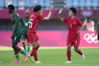 China's Wang Shuang (7) celebrates with her teammates after scoring a second goal against Zambia during a women's soccer match at the 2020 Summer Olympics, Saturday, July 24, 2021, in Saitama, Japan. (AP Photo/Andre Penner)