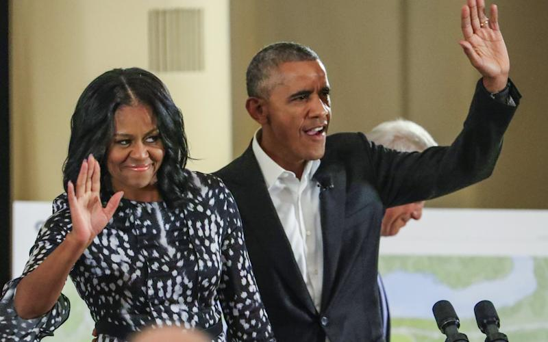 Former US President Barack Obama (R) and former US First Lady Michelle Obama (L) wave as they arrive to participate in a roundtable discussion and community meeting on the Obama Presidential Center at the South Shore Cultural Center in Chicago, Illinois, USA, 03 May 2017.  - Credit: TANNEN MAURY/EPA