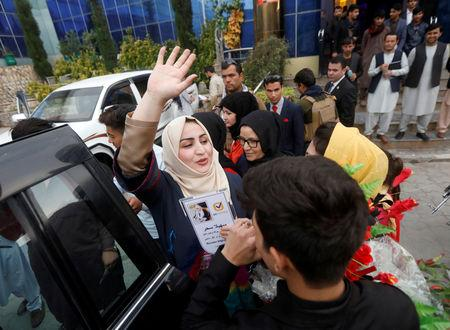 Female Afghan parliamentary election candidate, Suhaila Sahar, waves to supporters during an election campaign in Kabul, Afghanistan October 8, 2018. REUTERS/Omar Sobhani