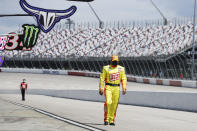 Driver Ryan Newman walks to his car for the start of the NASCAR Cup Series auto race Sunday, May 17, 2020, in Darlington, S.C. (AP Photo/Brynn Anderson)