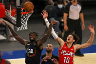 New York Knicks forward Julius Randle (30) and New Orleans Pelicans center Jaxson Hayes (10) battle for a rebound during the first half of an NBA basketball game Sunday, April 18, 2021, in New York. (AP Photo/Adam Hunger, Pool)