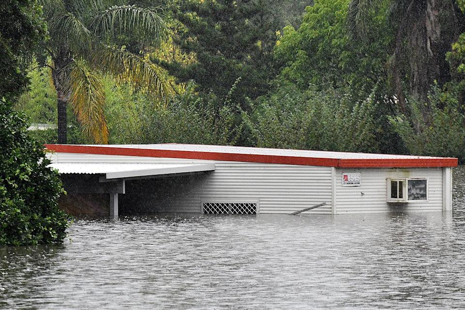 <p>A home is nearly submerged in water in Windsor, Australia, as Sydney and the surrounding area on Australia's east coast faces the worst flooding its seen in 60 years.</p>