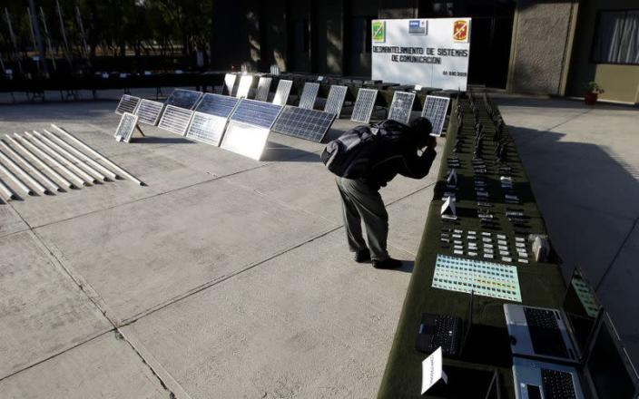 FILE PHOTO: A reporter takes a picture of radio communication systems displayed to the media at the 7th Military zone, on the outskirts of Monterrey