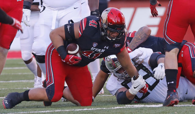 Utah defensive tackle Hauati Pututau (41) recovers a fumble against Oregon in the first half during an NCAA college football game Saturday Nov. 10, 2018, in Salt Lake City. (AP Photo/Rick Bowmer)