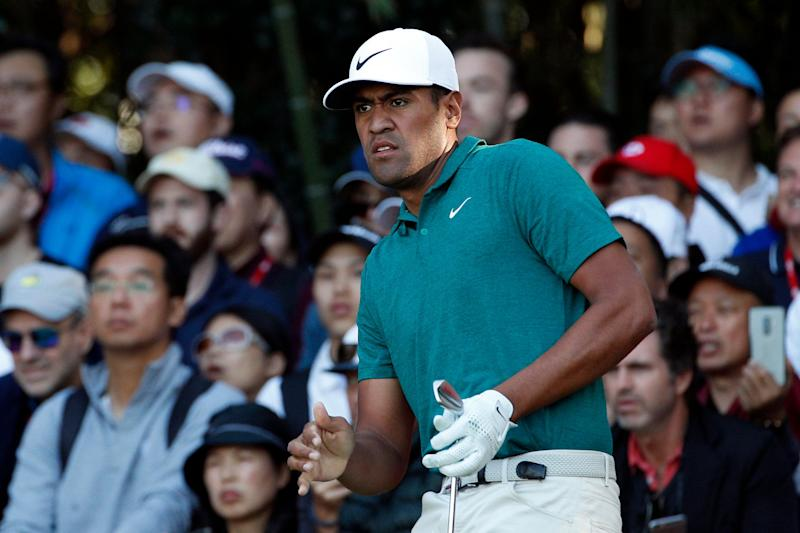Tony Finau of the United States reacts after tee off in the final round of the HSBC Champions golf tournament held at the Sheshan International Golf Club in Shanghai, Sunday, Oct. 28, 2018. (AP Photo/Ng Han Guan)