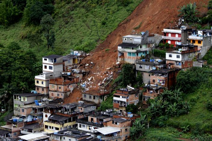 FILE - This Jan. 16, 2011 file photo shows an aerial view of a neighborhood affected by landslides in Nova Friburgo, Brazil U.N. climate experts say global warming accelerated since the 1970s, breaking more countries' temperature records than ever before. The World Meteorological Organization's analysis Wednesday, July 3, 2013 calls the first decade of the new millennium an unprecedented era of climate extremes ranging from heat waves in Europe and Russia, to droughts in the Amazon Basin, Australia and East Africa, to huge storms like Tropical Cyclone Nargis and Hurricane Katrina. (AP Photo/Felipe Dana, File)