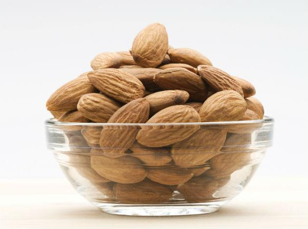 <b>Almonds:</b> Have you been avoiding nuts for the oil they contain? If yes, then bring it back to your plate because this oil is actually healthy for your heart. The Vitamin E that almonds contain helps in keeping your cholesterol level under control. Like apples, almonds are also high on fibre and Vitamin content. Again a perfect 5 PM snack. Add to your heart's health by eating 4–5 soaked almonds each morning with your breakfast.