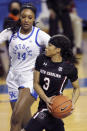 South Carolina's Destanni Henderson (3) drives near Kentucky's Tatyana Wyatt (14) during the second half of an NCAA college basketball game in Lexington, Ky., Sunday, Jan. 10, 2021. (AP Photo/James Crisp)