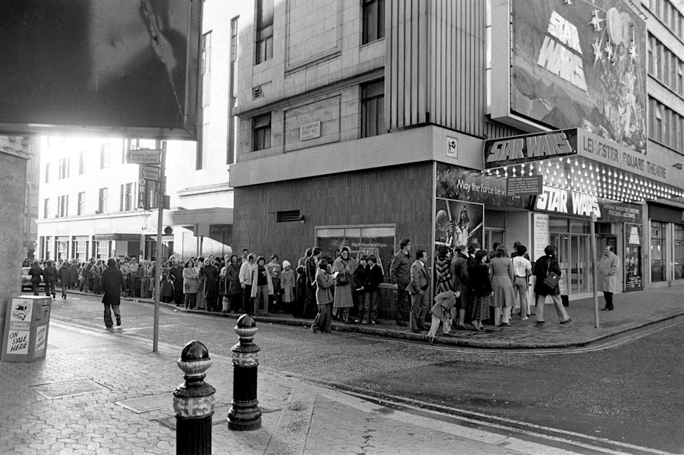 """The queue outside the Leicester Square Theatre, in the morning, for the London opening of the movie """"Star Wars"""".   (Photo by PA Images via Getty Images)"""