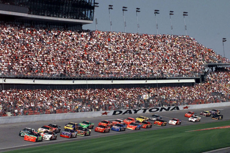 "FILE - In this Feb. 11, 1999, file photo, drivers in the first 125-mile Daytona 500 qualifying race start the race at Daytona International Speedway in Daytona Beach, Fla. Daytona Beach became the unofficial ""Birthplace of Speed"" in 1903 when two men argued over who had the fastest horseless carriage and decided things in a race on the white, hard packed sand along the Atlantic Ocean.(AP Photo/Chris O'Meara, File)"
