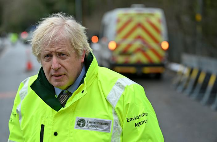 Britain's Prime Minister Boris Johnson talks to members of the media after being shown the Environment Agency's flood defence preparations during his visit to Withington in Manchester, northwest England as Storm Christoph brings heavy rains and flooding across the country on January 21, 2021. (Photo by Paul ELLIS / various sources / AFP) (Photo by PAUL ELLIS/AFP via Getty Images)