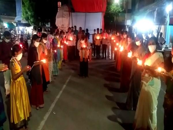 A candle-light protest was held by the BJP and JSP against the series of attacks on temples in the state. (Photo/ANI)
