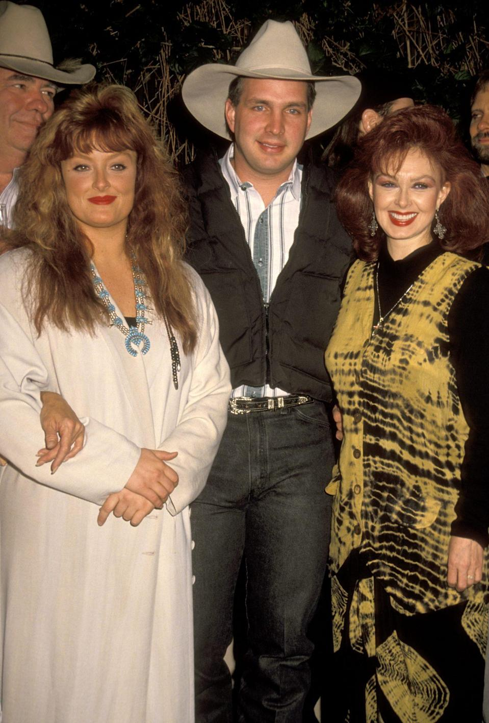<p>Wynonna Judd, Brooks and Naomi Judd get together at the Love Is Feeding Everyone Country Christmas Benefit in December 1990 at the Universal Ampitheater in Universal City, California.</p>